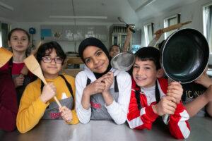 Children cooking in Rhyl Kitchen Classroom